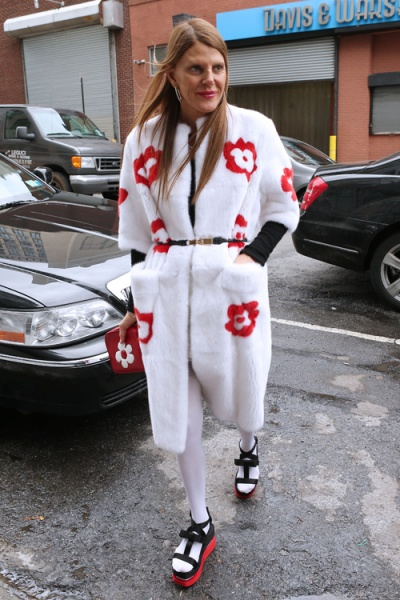Vogue Italia editor Anna Dello Russo, wearing a white fuzzy coat with red and white daisies, arrives at Victoria by Victoria Beckham fashion show in New York City