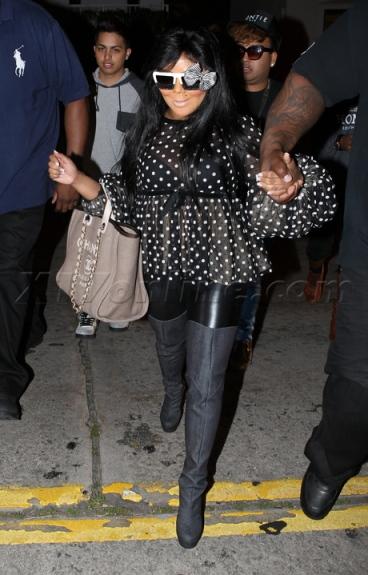 Lil Kim rocking funky shades at the NAACP Awards